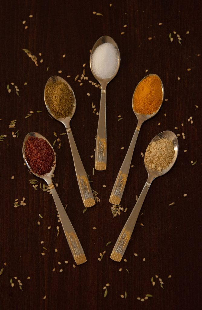 spoons of celery salt and other spices